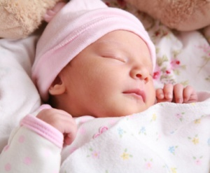 Portrait of a newborn girl sleeping